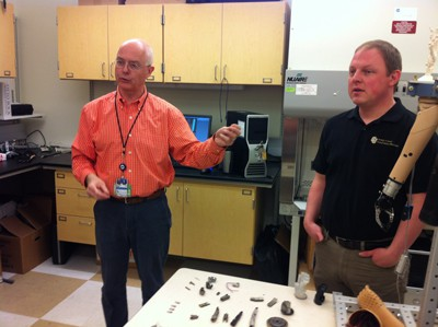 Dr. Richard Weir and research assistant Stephen Huddle explain their bioengineering design and research to make robotic hands.